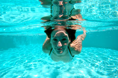 Swimming 1. Woman swimming underwater stock images