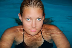 Swimming. Girl in Swimming pool at afternoon Royalty Free Stock Photography