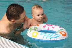 Swimming. Little boy  with his father  at swimming lesson Stock Photos