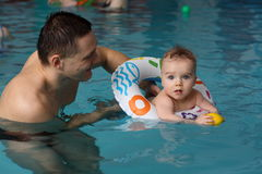 Swimming. Little boy  with his father  at swimming lesson Stock Image
