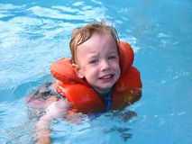 Swimming. Learning to swim Royalty Free Stock Image