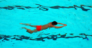 Swimming. A man swimming in a pool Stock Images
