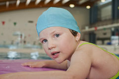 Swimming. Portrait of a young girl in the swimming-pool Stock Image