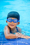 Swimming. Small girl swimming in the pool Royalty Free Stock Image