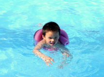 Swimming. A boy is swimming in a swimming pool Royalty Free Stock Images