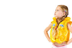 Swimming. Young girl with yollow lifejacket Royalty Free Stock Photo