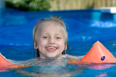 Swimming. Young child is swimming in the pool Stock Image
