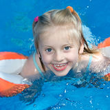 Swimming. Young child is swimming in a pool Stock Image