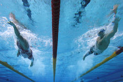 Swimming action 1. Freestyle race shot from underwater looking up Stock Image
