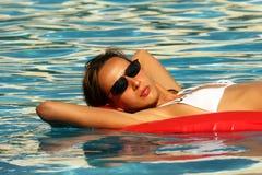 Swimming on an air mattress Stock Photo