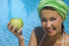Before swimming an apple. For a healthy life what you eat and what you do is important Stock Photos
