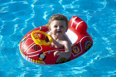 Swimming baby Stock Photography