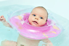 Swimming baby Stock Image