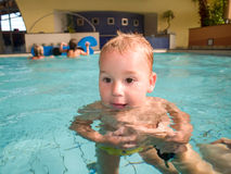 Swimming baby Stock Photos