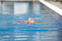 Swimming the backstroke Royalty Free Stock Photo
