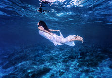 Swimming in beautiful blue sea Royalty Free Stock Images