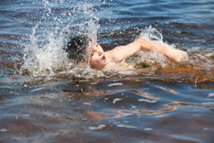 Swimming boy Stock Images