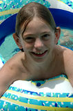 Swimming boy. Boy swimming in pool with intertube Royalty Free Stock Image