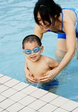 Swimming boy and mother Royalty Free Stock Photos