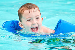 Swimming boy in pool with big smile Royalty Free Stock Images