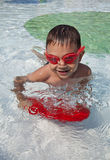 Swimming boy in pool Royalty Free Stock Image