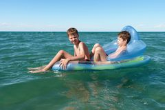 Swimming boys Stock Image