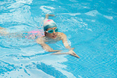 Swimming breaststroke. Girl swimming breaststroke in the pool Royalty Free Stock Photos