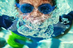 Swimming and bubbles royalty free stock photography