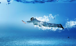 Swimming businessman Royalty Free Stock Image