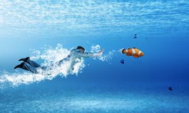 Swimming businessman Stock Images