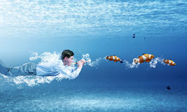 Swimming businessman Royalty Free Stock Photos