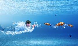 Swimming businessman Royalty Free Stock Photo