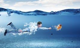 Swimming businessman Stock Photo