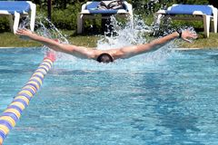 Swimming Butterfly professional. Professional Butterfly Swimmer in the outdoor pool Stock Image