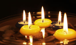 Swimming candles Stock Photos