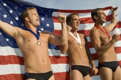 Swimming Champions Cheering With Clenched Fists Stock Photo