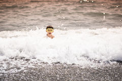 Swimming child Stock Photos