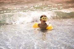Swimming child Stock Photos