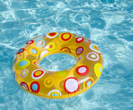 Swimming circle in a pool. Bright kid's swimming circle in the pool Stock Image