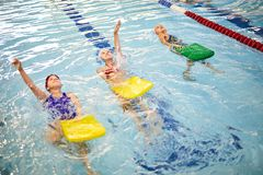 Swimming class in pool stock photography