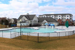 Swimming Pool. Clubhouse and large swimming pool outdoor Royalty Free Stock Photography