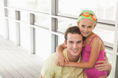 Swimming coach with cute little girl Royalty Free Stock Images
