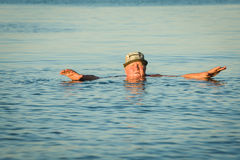 Swimming in cold water Stock Images