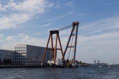 Swimming construction crane Stock Photos