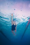 Swimming in crawl style Stock Photos