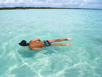 Swimming in crystalline clear sea in Brazil Stock Photography