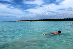 Swimming in crystalline clear waters in Brazil Royalty Free Stock Images