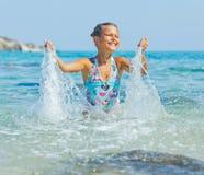 Swimming cute girl Stock Photo
