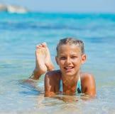 Swimming cute girl Stock Image