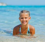 Swimming cute girl Stock Image